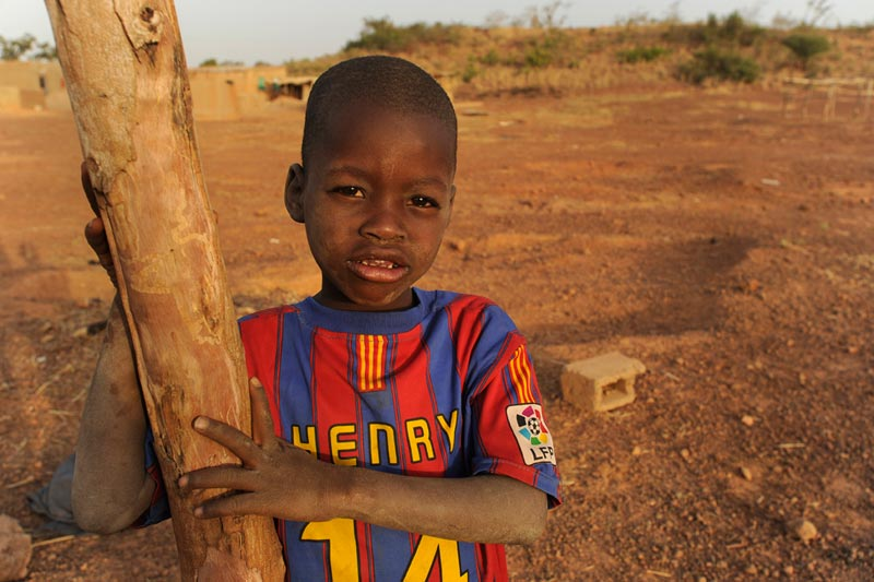 Burkina Faso Boy Leaning on a Tree