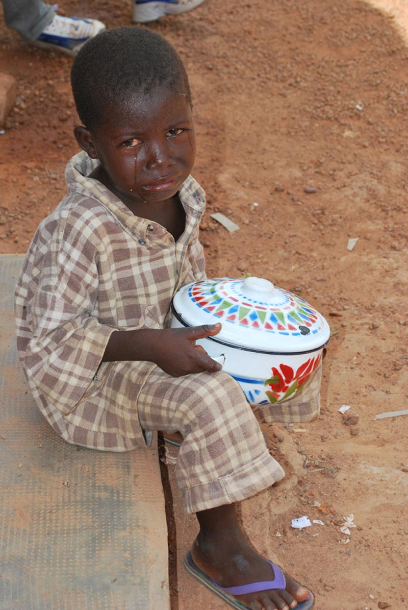 Burkina Faso Crying Boy Holding Bowl