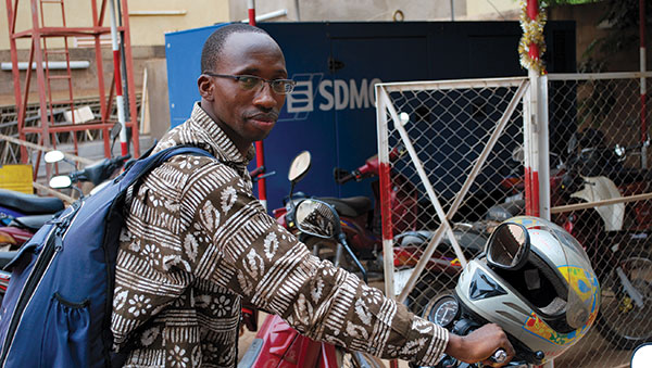 Burkina Faso Partnership Facilitator on a Motorcycle