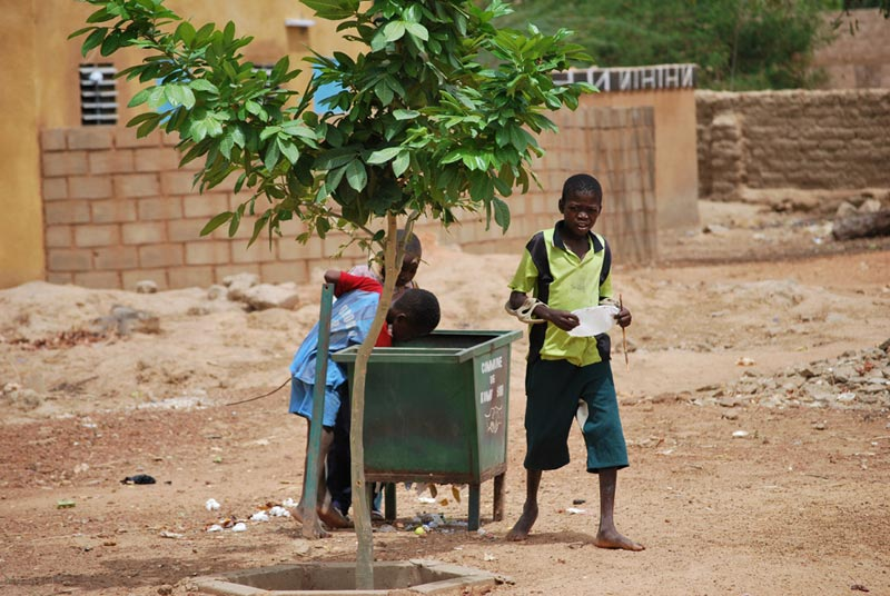 Burkina Faso Three Children at a Bin