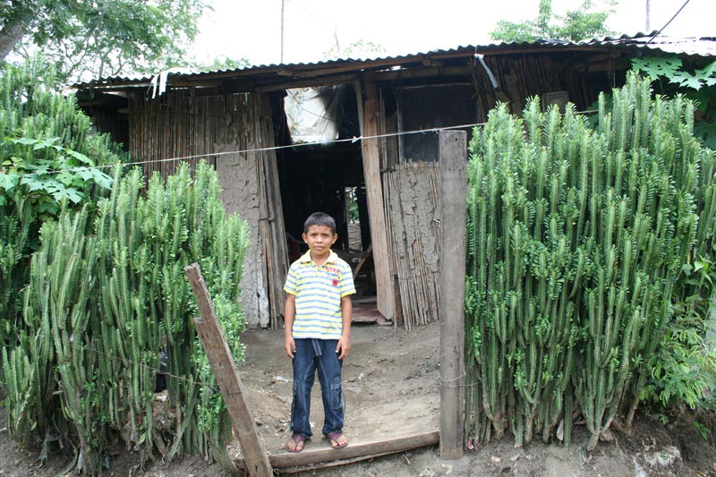 Colombia Boy in Front of His Home