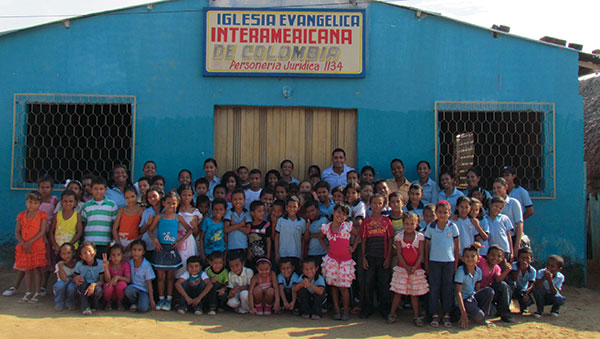 Colombia Children and Staff Outside of Center