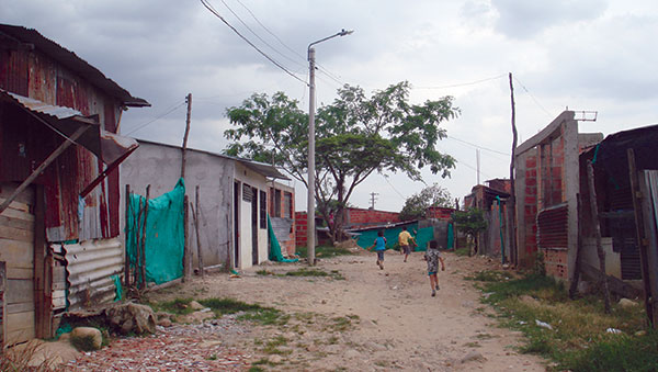 Colombia Children in Road Between Homes