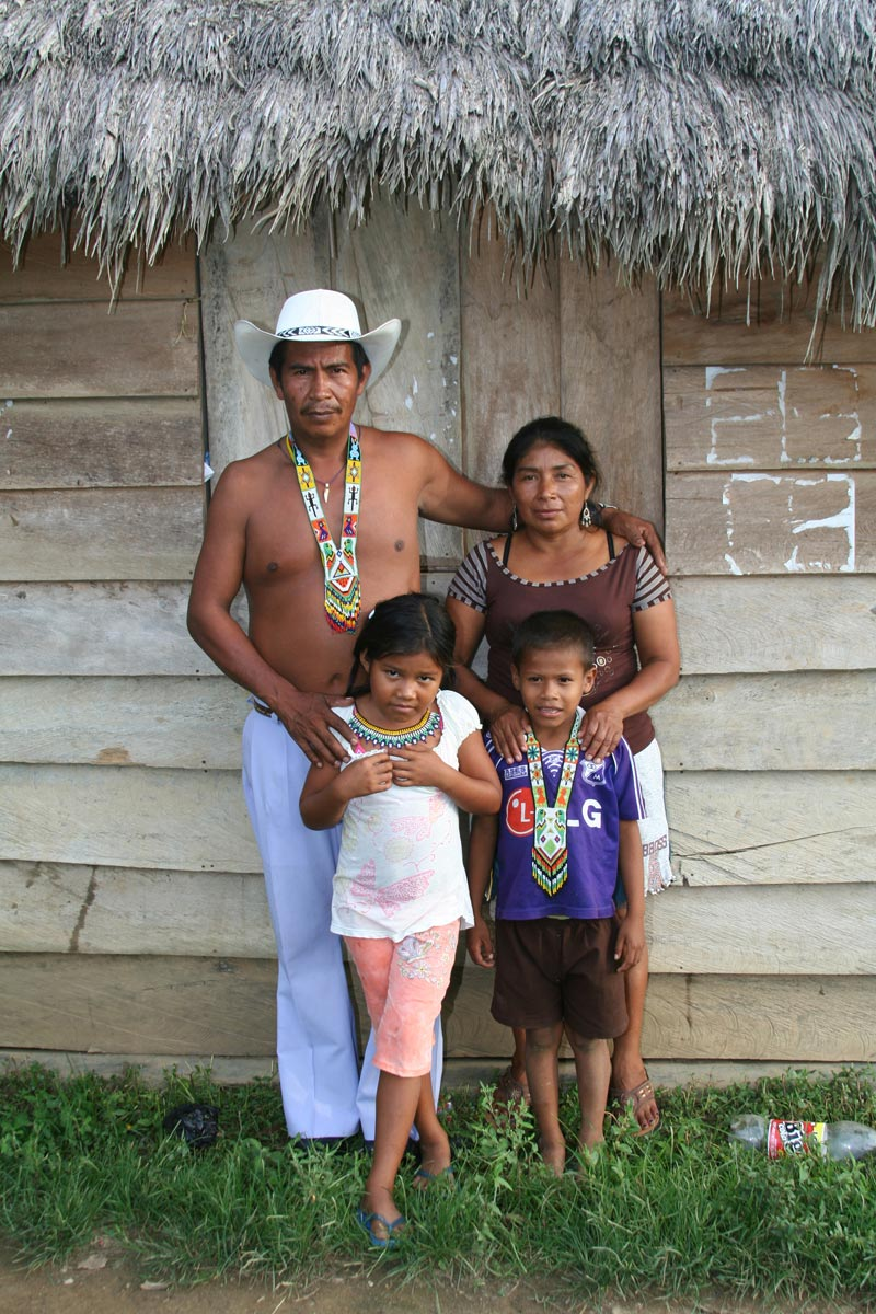 Colombia Family Outside of Their Home