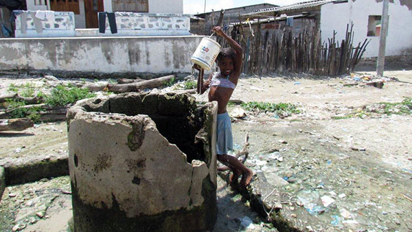 Colombia Girl at Water Well