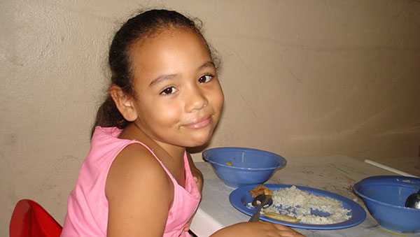 Colombia Girl With a Plate of Food