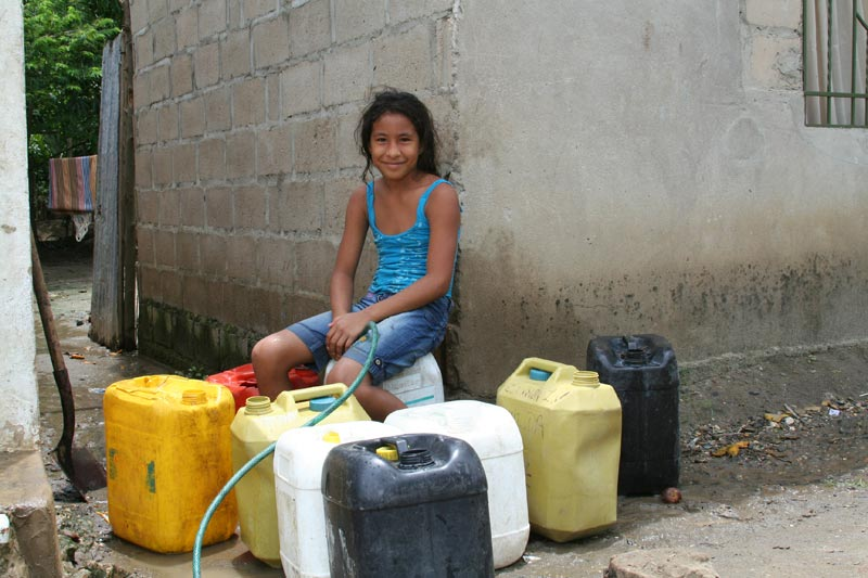 Colombia Girl With Water Containers