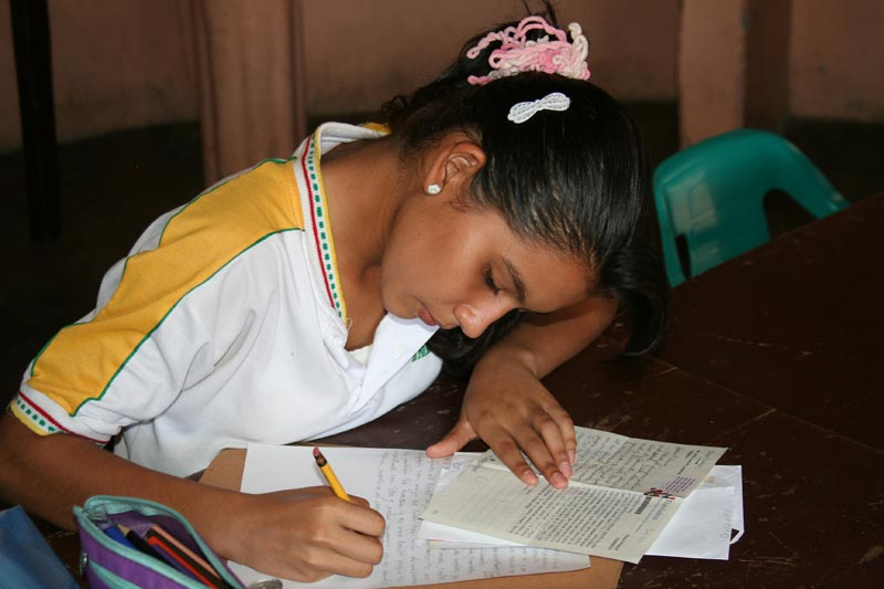 Colombia Girl Writing to Her Sponsors