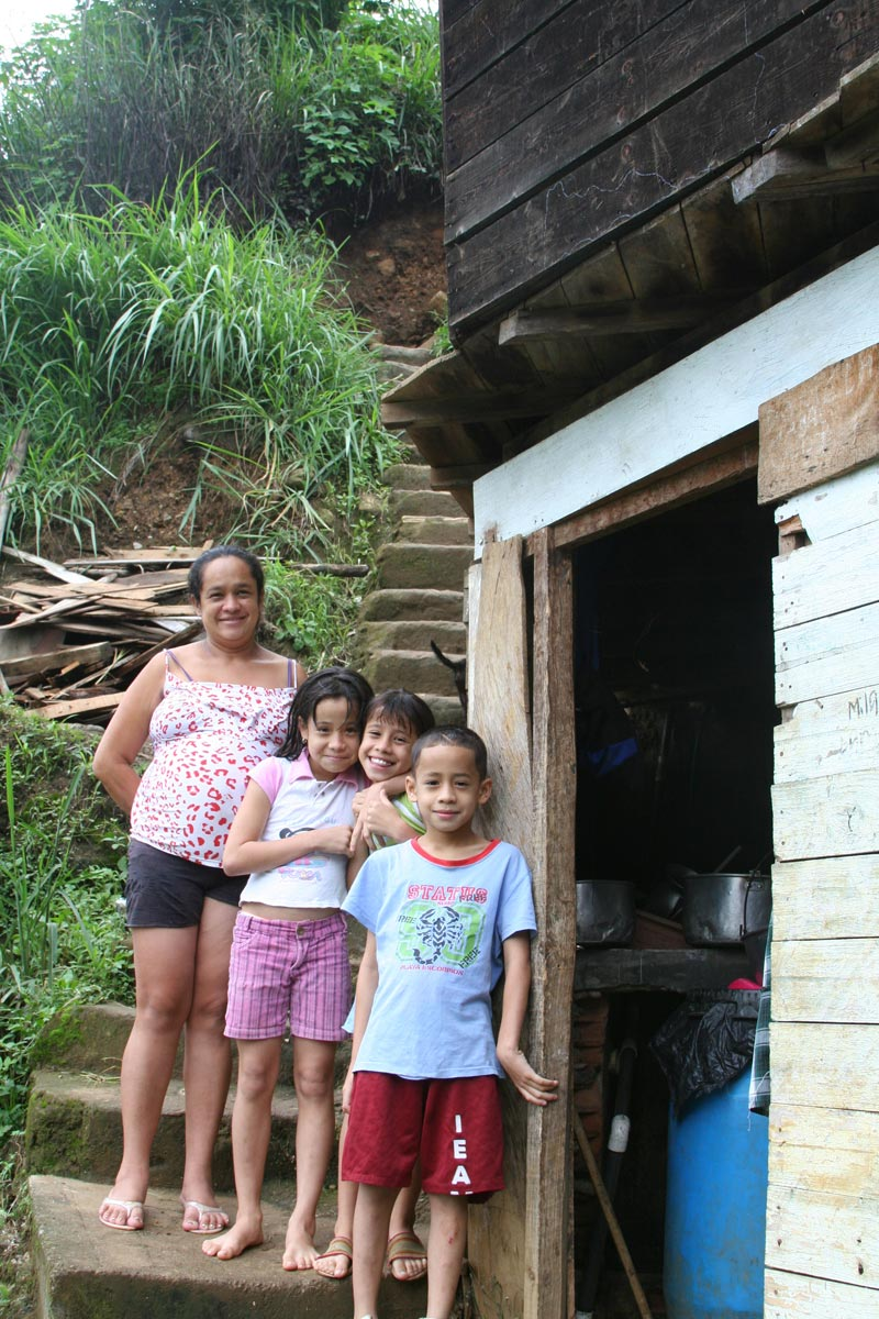 Colombia Mother and Her Children Outside of Their Home