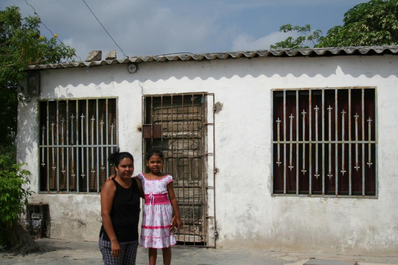 Colombia Mother and Girl in Front of Their Home