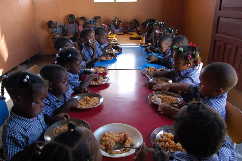 Dominican Republic Children Eating a Nutritious Meal at the Center