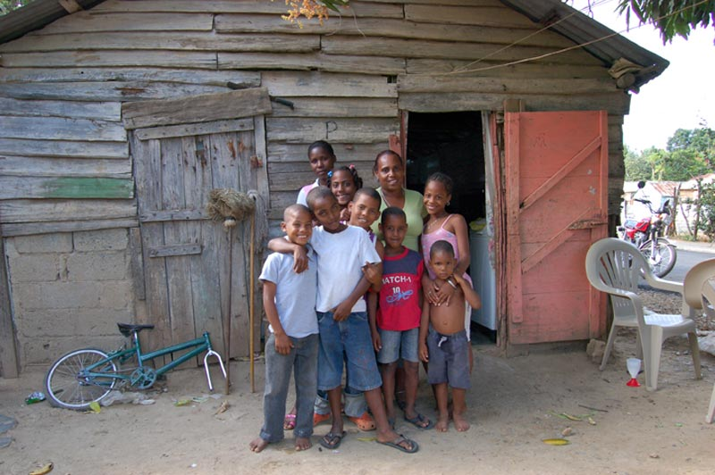Dominican Republic Family in Front of Home
