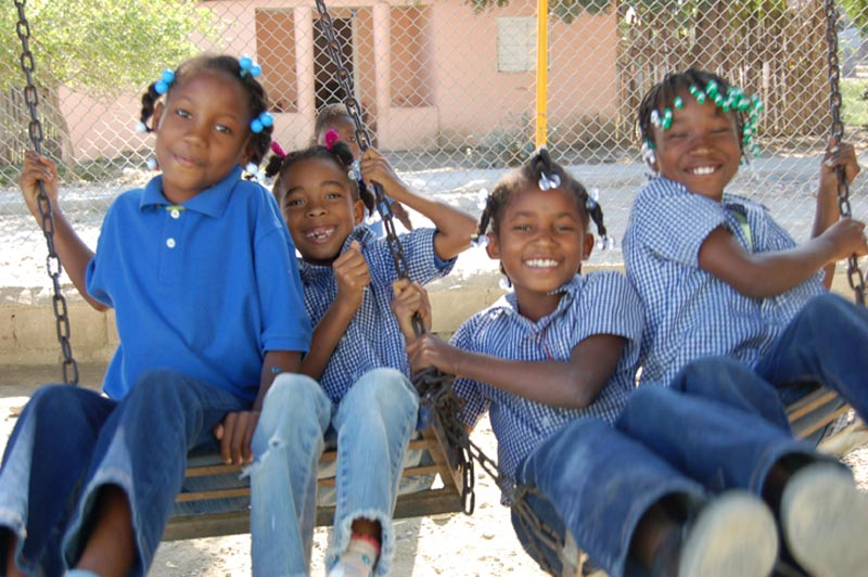 Dominican Republic Girls on the Swings