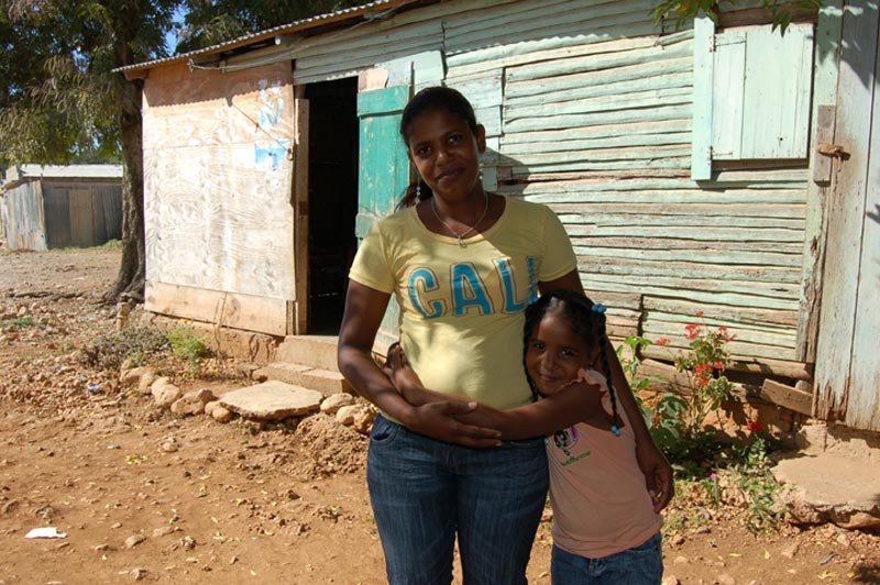 Dominican Republic Mother and Daughter Outside of Home
