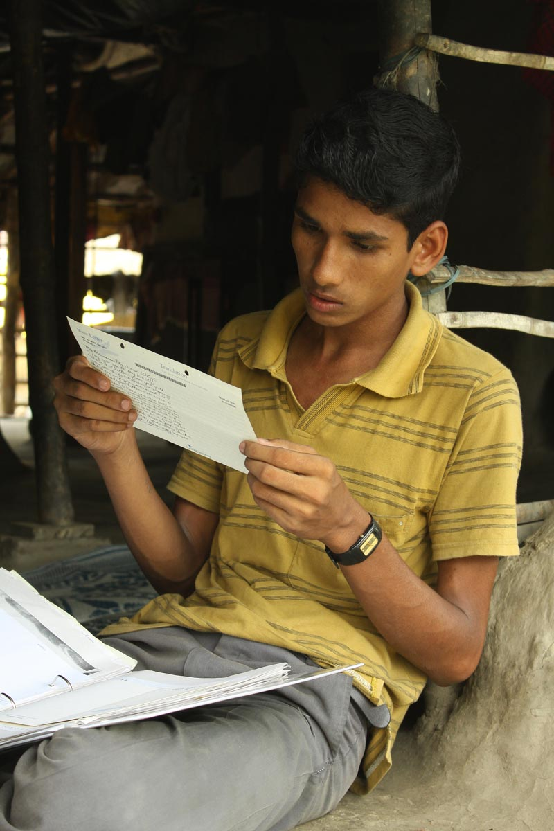 East India boy reading sponsor letter