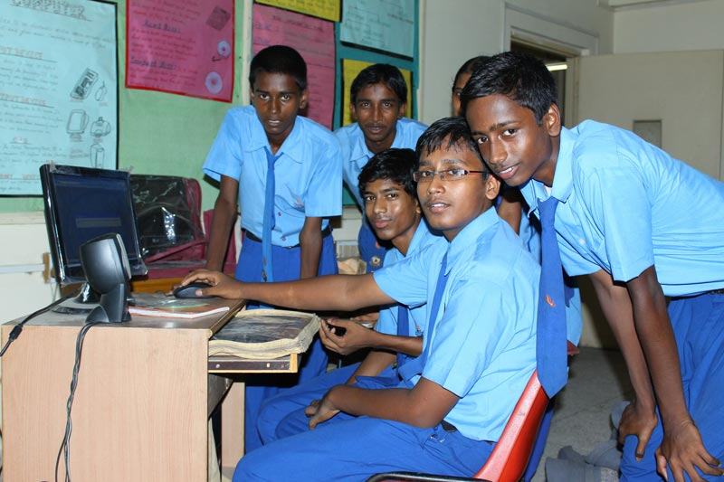 East India boys at computer