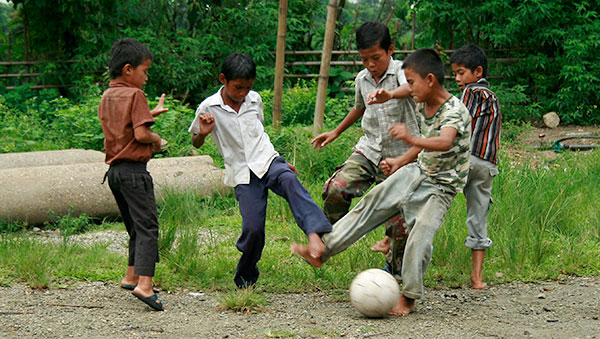 East India boy playing soccer