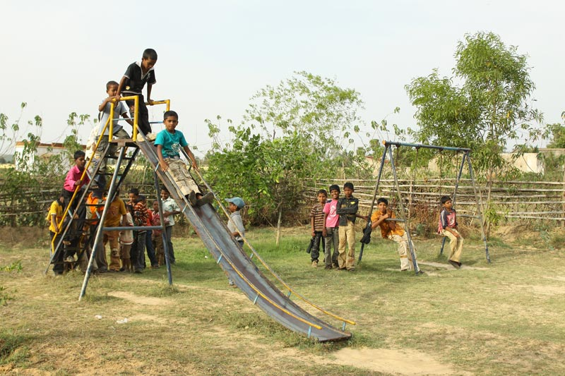 East India children on slide