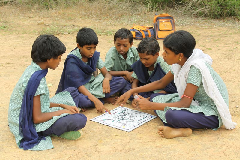 East India Children Playing a Boardgame
