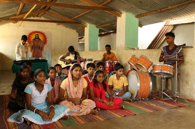 East India children singing with band