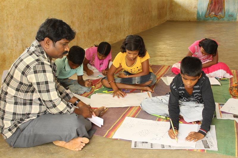 East India children studying on ground