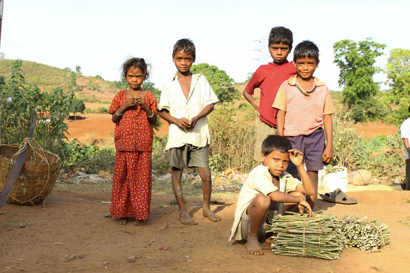 East India children with stick bundles