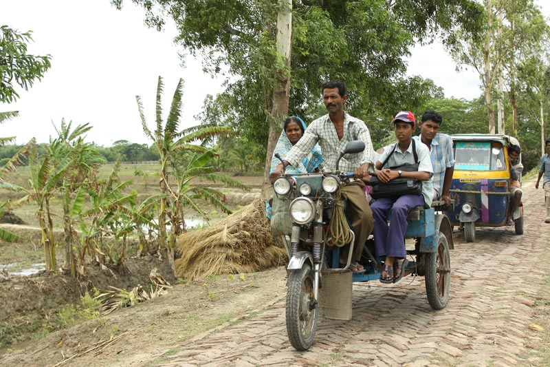East India family on motorbike