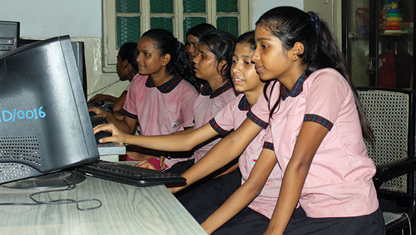 East India girls at computer