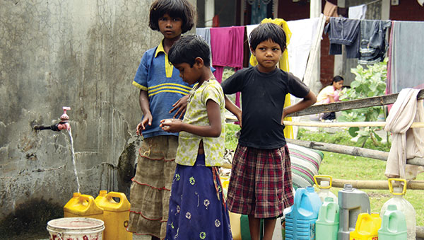East India girls getting water