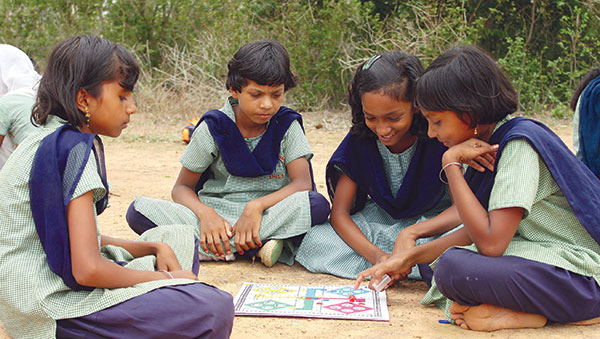 East India girls playing board game