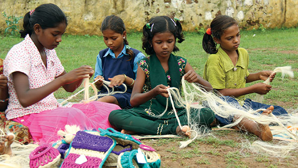 East India girls weaving rope