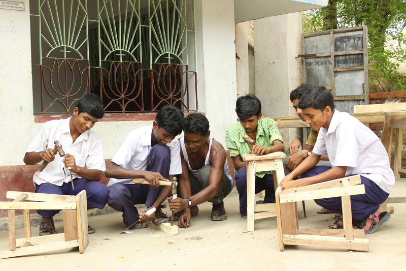 East India men building stools