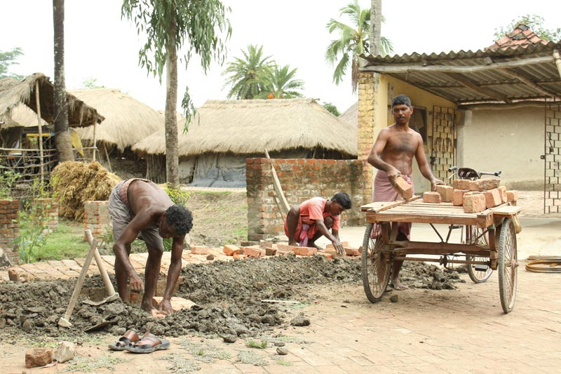 East India men making bricks