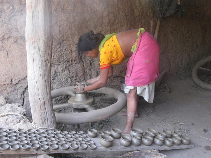 East India woman making pottery