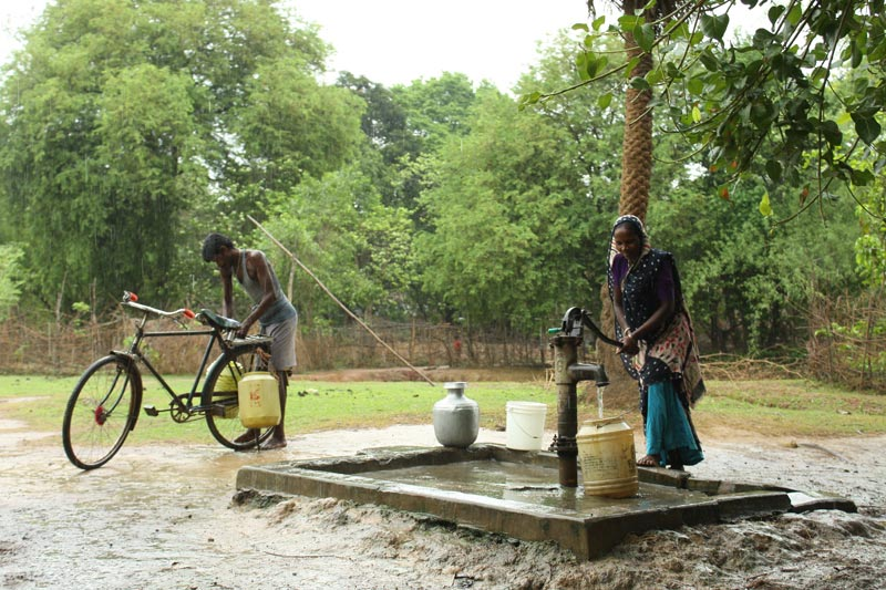 East India Woman Pumping Water