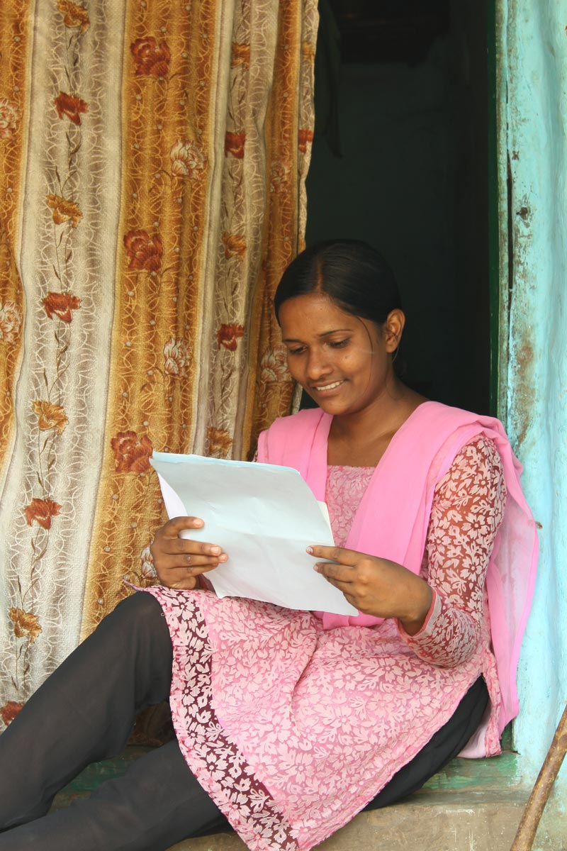 East India woman reading letter