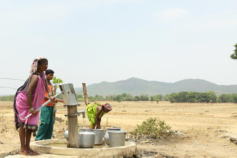East India women pumping water