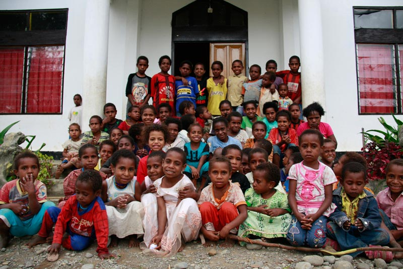 East Indonesia children in front of center