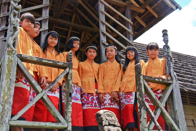 East Indonesia girls standing on porch