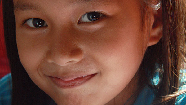 East Indonesia smiling girl closeup
