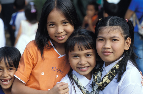 East Indonesia three girls smiling
