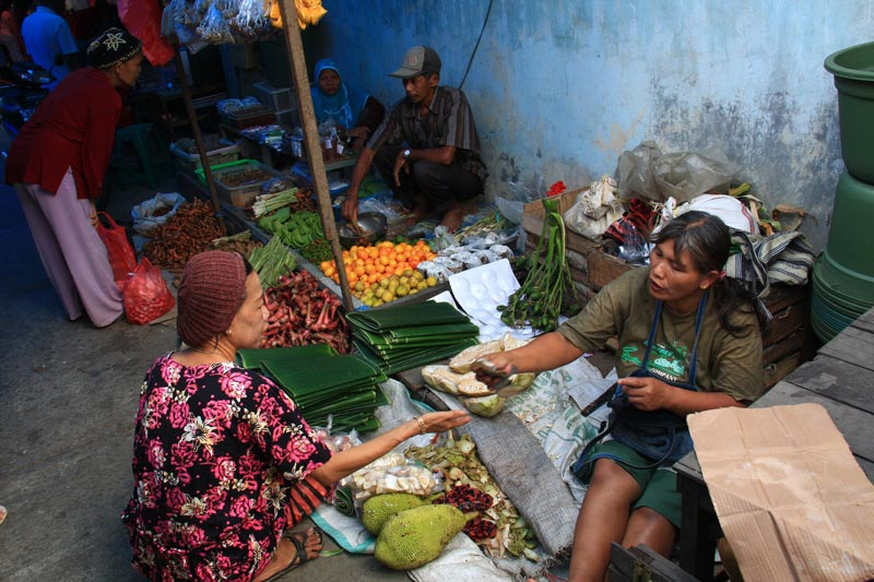 East Indonesia woman buying produce