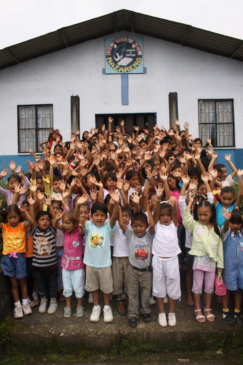 Ecuador Children Raising Hands