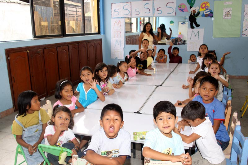Ecuador Children Sitting at Classroom Tables