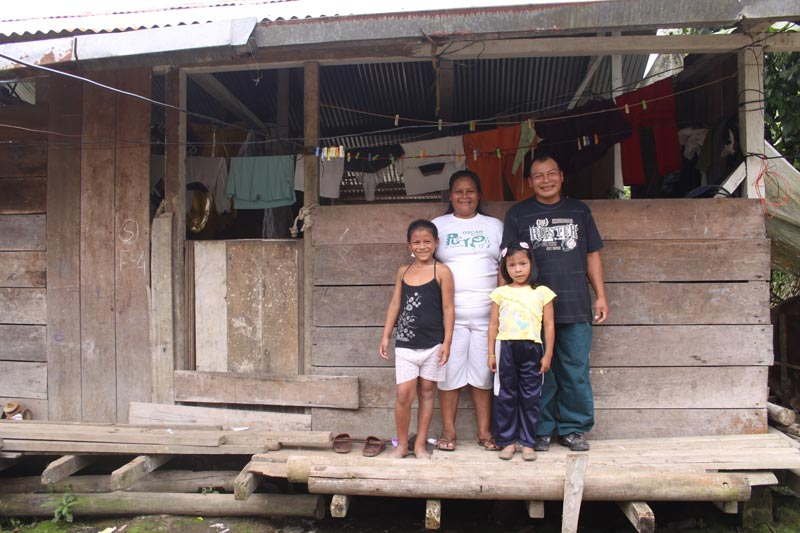 Ecuador Family Outside of Home