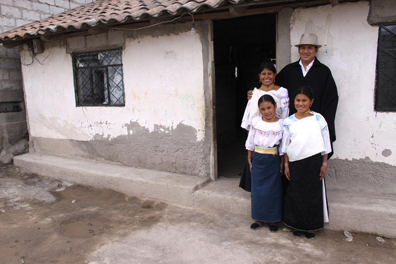 Ecuador Family Standing Outside Their Home
