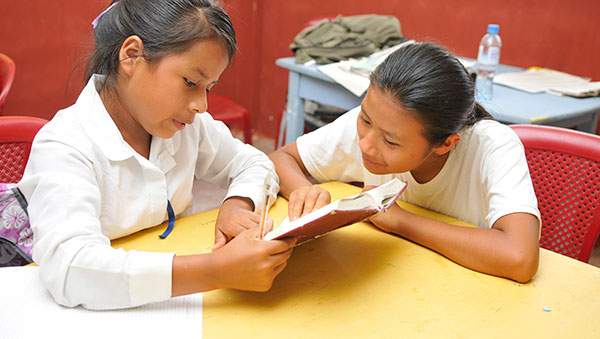 Ecuador Girls Reading a Book