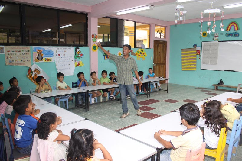 Ecuador Children in Classroom Listening to Teacher