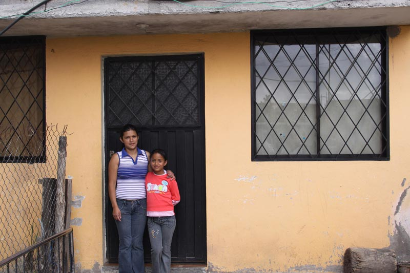 Ecuador Woman and Daughter in Home's Doorway