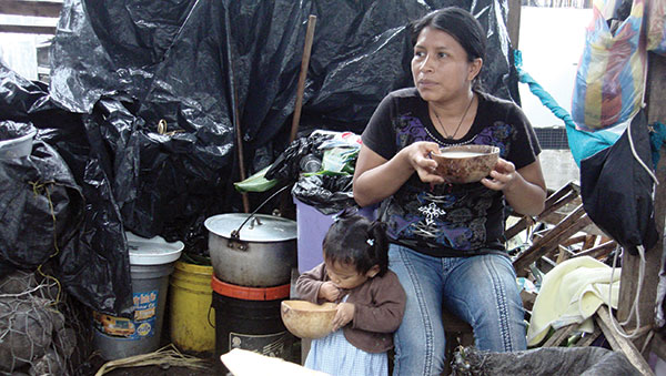 Ecuador Mother and Daughter Drinking Chicha